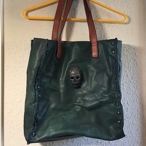 Green leather bag with skull